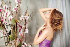 Portrait of a woman with flowers. Portrait in profile of sensual woman with flowers Stock Images