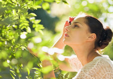 Portrait of woman in foliage looking on copy space Stock Photo