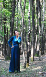 Portrait of a woman in the forest Stock Images
