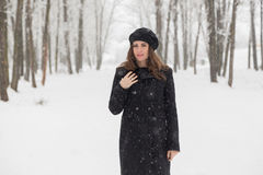 Portrait of a woman in the forest. Winter portrait of a young woman in the forest covered by snow Royalty Free Stock Image