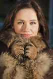 Portrait of woman in fox coat Stock Photo
