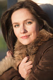 Portrait of woman in fox coat Stock Image