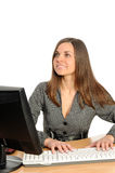 Portrait of the woman  in front of her computer Royalty Free Stock Photography