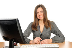 Portrait of the woman  in front of her computer Royalty Free Stock Photos