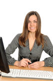 Portrait of the woman  in front of her computer Royalty Free Stock Image