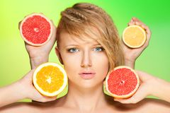 Portrait of woman with fruits Stock Photo