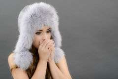 Portrait of woman in fur cap Royalty Free Stock Images