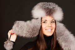 Portrait of a woman in fur hat Stock Images