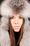Portrait of a woman in fur hat Stock Photos