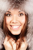 Portrait of a woman in fur hat. Smiling young woman in fur hat Royalty Free Stock Photos