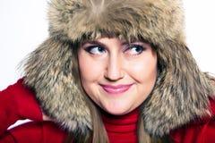 Portrait of a woman in a fur hat. Cute portrait of a woman in a fur hat Stock Photos