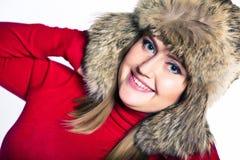 Portrait of a woman in a fur hat. Cute portrait of a woman in a fur hat Stock Photography
