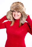Portrait of a woman in a fur hat and a red sweater Stock Images