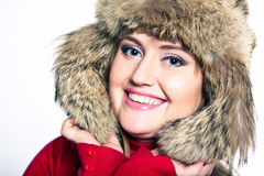 Portrait of a woman in a fur hat and a red sweater Royalty Free Stock Images
