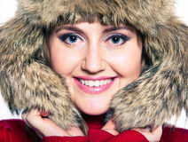 Portrait of a woman in a fur hat and a red sweater. Cute portrait of a woman in a fur hat and a red sweater Royalty Free Stock Photo