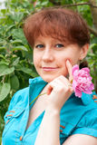 Portrait of a woman in a garden. Portrait of a beautiful woman in garden Royalty Free Stock Images
