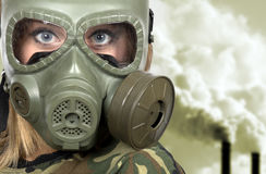 Portrait of woman in gas-mask - in toxic environment Stock Image