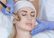 Portrait of woman getting rf-lifting. Rf lifting procedure. In a beauty parlour stock photography