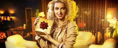 Portrait of the woman with a gift Royalty Free Stock Photography