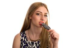 Portrait of woman, girl lick candy beautiful makeup isolated on Stock Photography