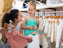 Portrait of  woman and girl shopping white baby apparel in cloth Stock Photography