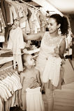Portrait of  woman and girl shopping white baby apparel in cloth Royalty Free Stock Photos