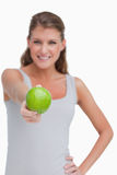 Portrait of a woman giving an apple Royalty Free Stock Photography