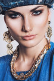 Portrait of woman with golden earrings and necklace Stock Photo