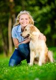 Portrait of woman with golden retriever Royalty Free Stock Photo