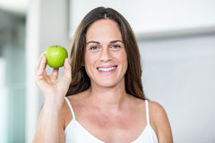 Portrait of woman with Granny Smith Royalty Free Stock Image