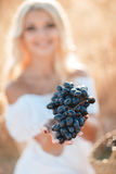 Portrait of a woman with grape in hands Royalty Free Stock Images