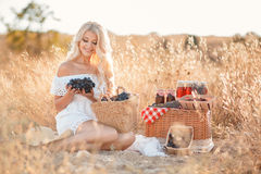Portrait of a woman with grape in hands Royalty Free Stock Image