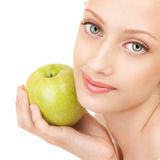 Portrait of a woman with green apple Stock Images