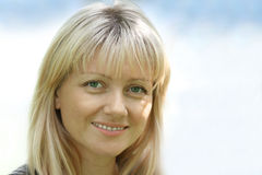 Portrait of the woman with green eyes royalty free stock photography
