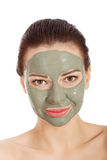 Portrait of a woman in green face mask Stock Photo
