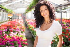 Portrait of a woman in a greenhouse Stock Images