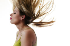 Woman with hair flying in the air on white background Royalty Free Stock Images