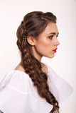Portrait of woman with hair style. Portrait of brunet woman with hair style braids Royalty Free Stock Photo