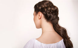 Portrait of woman with hair style. Portrait of brunet woman with hair style braids Stock Image