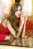 Portrait of woman in hall of hotel. Portrait of beautiful single woman in red dress in hall of hotel stock photography