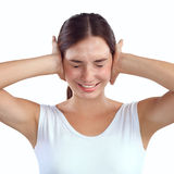 Portrait of woman with hands on ears Stock Photos