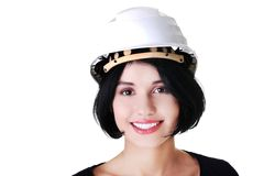 Portrait of a woman with hardhat looking at camera Stock Photography