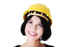Portrait of a woman with hardhat looking up Stock Images