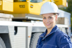 Portrait woman in hardhat next to plant machinery Royalty Free Stock Photography