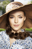 Portrait of woman in the hat. Close-up portrait of a beautiful young woman with braid hairdo in the hat Royalty Free Stock Photography