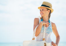 Portrait of woman in hat and with bag looking on copy space Royalty Free Stock Photo