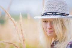 Portrait of woman in a hat in a field Stock Photos
