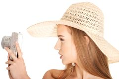 Portrait of a woman in hat taking photos Stock Images