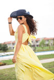Portrait of a woman with hat and yellow dress Stock Photo