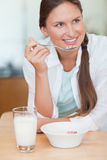 Portrait of a woman having breakfast Royalty Free Stock Images